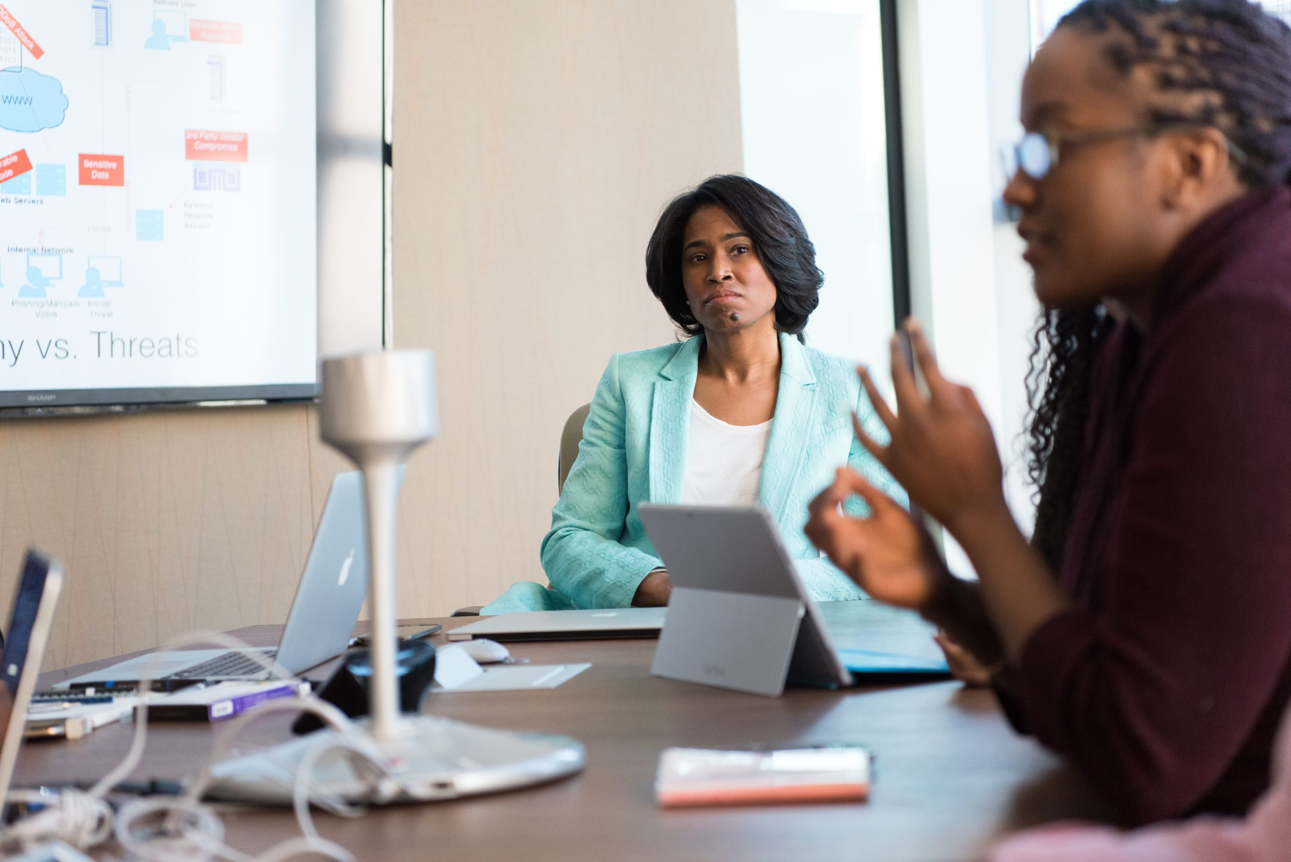 Business women making decisions in a conference room